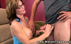Mature brunette giving handjob