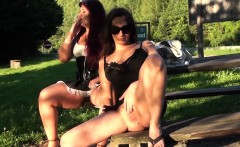 Two lesbians casually flash their pussies in a public park