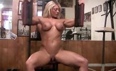 Busty blonde muscle builder is in the gym working out naked