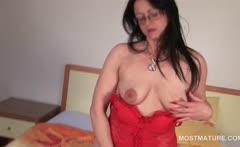 Mature brunette seductress working her trimmed snatch